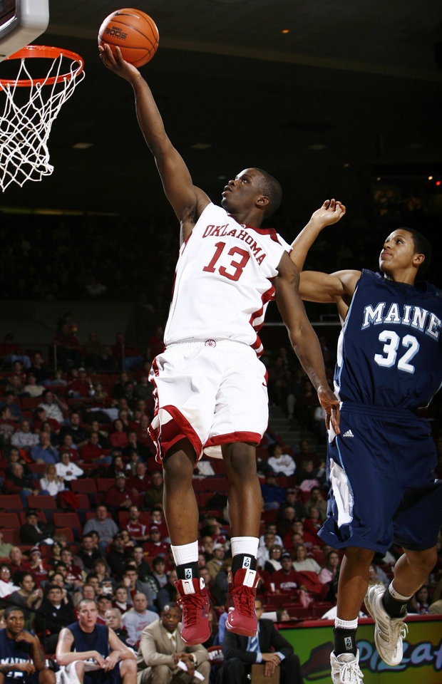 Photo - OU's Willie Warren (13) lays up the ball in front of Gerald McLemore (32) of Maine in the first half of the men's college basketball game between University of Oklahoma and Maine at the Lloyd Noble Center in Norman, Okla., Wednesday, December 10, 2008. BY NATE BILLINGS, THE OKLAHOMAN  ORG XMIT: KOD