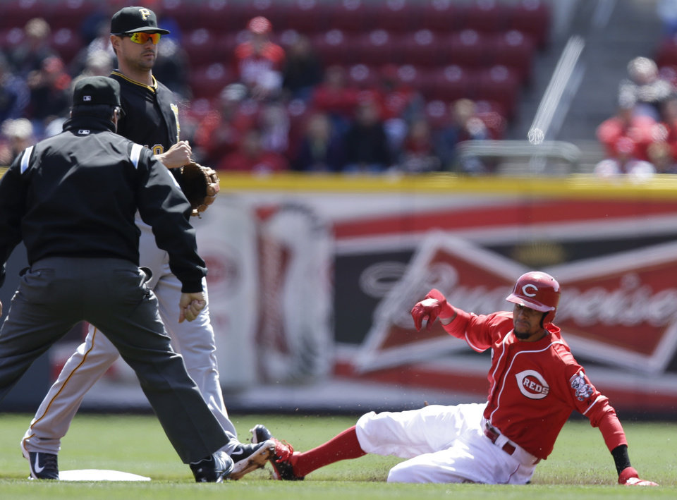 Photo - Cincinnati Reds' Billy Hamilton, right, steals second base as Pittsburgh Pirates second baseman Neil Walker waits for the ball in the first inning of a baseball game, Wednesday, April 16, 2014, in Cincinnati. (AP Photo/Al Behrman)