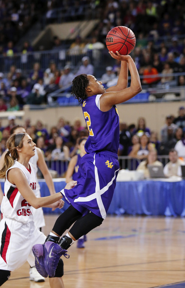 Photo - Anadarko shooter Tandra King launches a shot in front of Ft. Gibson's Grace Parker during the Class 4A State championship game between Ft. Gibson and Anadarko at Jim Norick Arena at State Fair Park  on Saturday, Mar. 15, 2014. Ft. Gibson came from behind much of the second half to win 50-47.  Photo by Jim Beckel, The Oklahoman