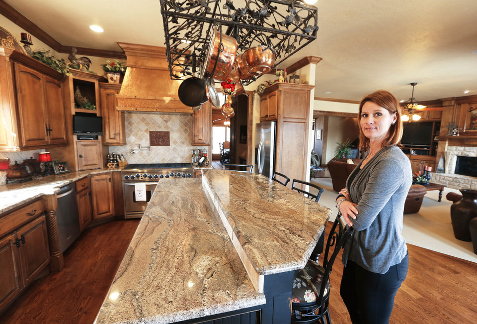 Photo - Homebuilder Denise Patterson shows the kitchen of her own home at 18270 N Antler Way in Deer Creek. Photos by Steve Gooch, The Oklahoman