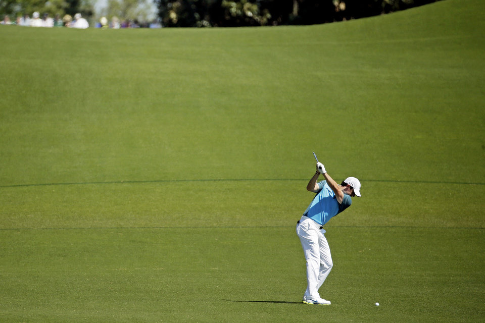 Photo - Rory McIlroy, of Northern Ireland, prepares to hit on the eighth fairway during the third round of the Masters golf tournament Saturday, April 12, 2014, in Augusta, Ga. (AP Photo/Chris Carlson)