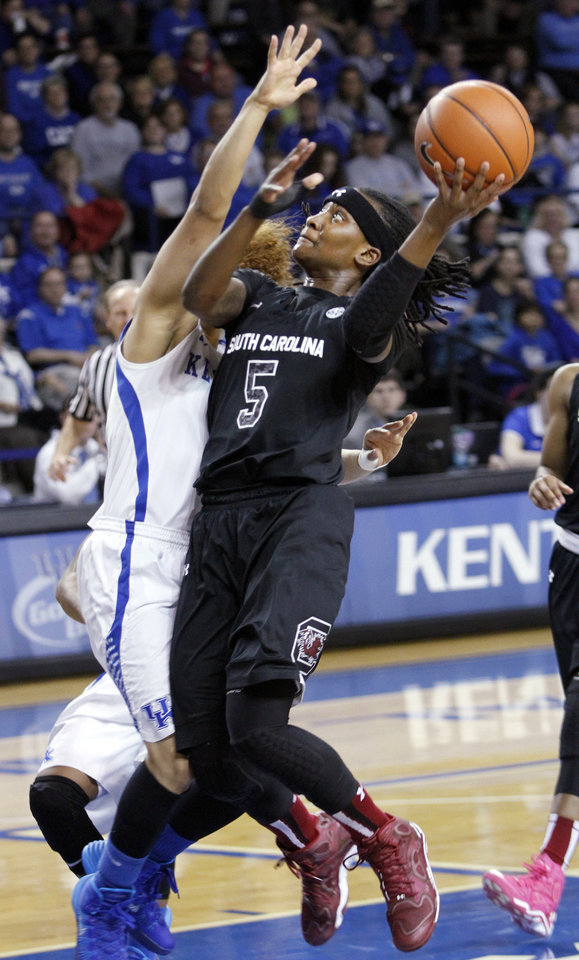Photo - South Carolina's Khadijah Sessions (5) shoots as Kentucky's Jennifer O'Neill defends during the first half of an NCAA college basketball game, Thursday, Feb. 20, 2014, in Lexington, Ky. (AP Photo/James Crisp)