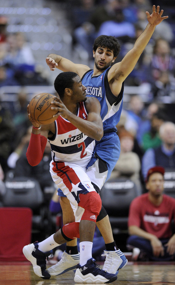 Washington Wizards guard John Wall (2) tries to get around Minnesota Timberwolves guard Ricky Rubio, of Spain, during the first half of an NBA basketball game on Friday, Jan. 25, 2013, in Washington. (AP Photo/Nick Wass)