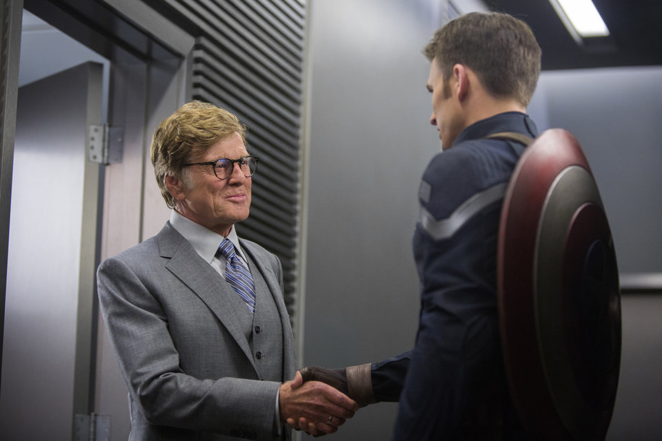 Photo - This image released by Marvel shows Robert Redford, left, and Chris Evans in a scene from