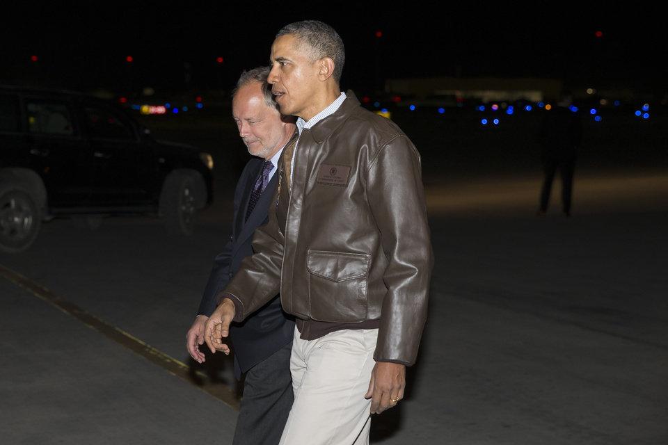 Photo - President Barack Obama walks with US Ambassador to Afghanistan James Cunningham after arriving at Bagram Air Field for an unannounced visit, on Sunday, May 25, 2014, north of Kabul, Afghanistan. (AP Photo/ Evan Vucci)