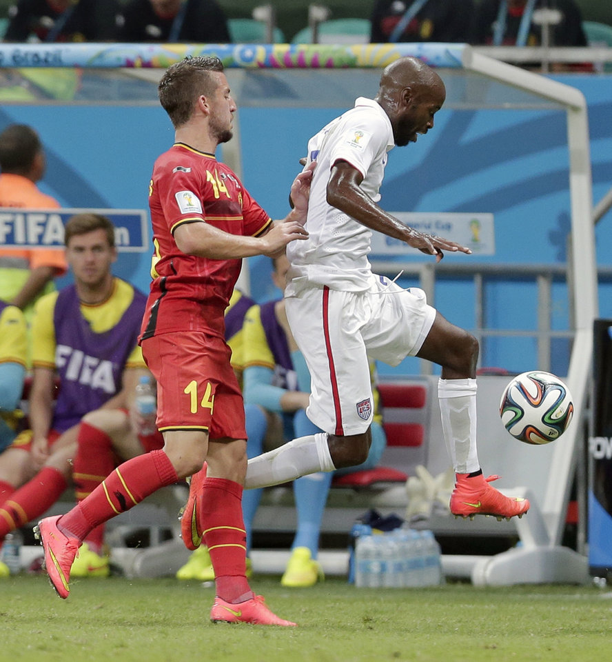 Photo - Belgium's Dries Mertens, left, pushes United States' DaMarcus Beasley to get him out of bounds during the World Cup round of 16 soccer match between Belgium and the USA at the Arena Fonte Nova in Salvador, Brazil, Tuesday, July 1, 2014. (AP Photo/Marcio Jose Sanchez)