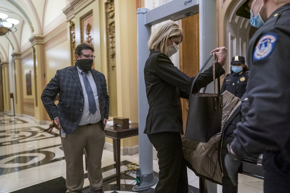 Photo - Metal detectors are set up for lawmakers and staff before entering the House chamber, a new security measure put into place after a mob loyal to President Donald Trump stormed the Capitol, in Washington, Tuesday, Jan. 12, 2021. The House is trying to push the vice president and Cabinet to act even more quickly to remove President Donald Trump from office. Democrats are set to pass a resolution calling on Vice President Mike Pence to invoke constitutional authority under the 25th Amendment to oust Trump. (AP Photo/J. Scott Applewhite)