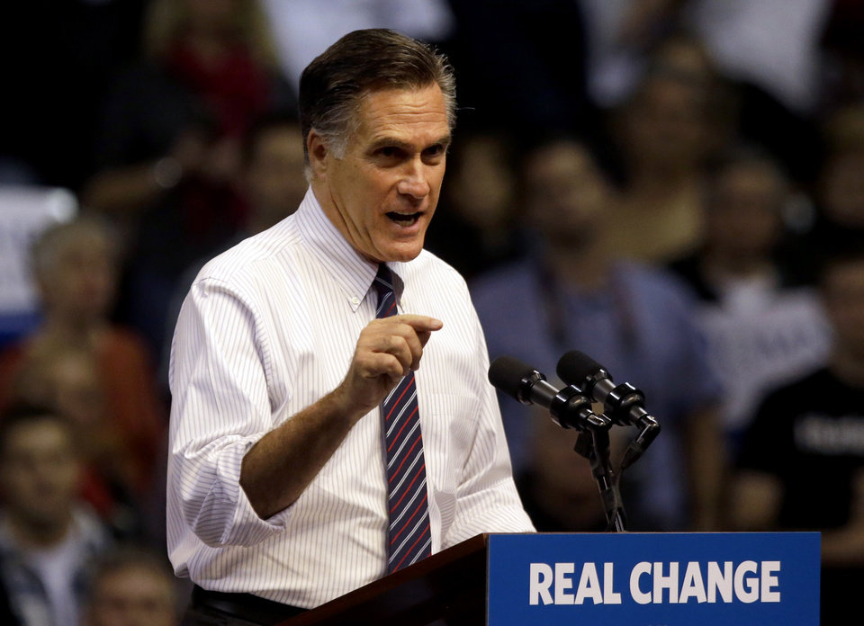 FILE - In this Nov. 5, 2012, file photo, Republican presidential candidate, former Massachusetts Gov. Mitt Romney speaks at a campaign event at the Verizon Wireless Arena in Manchester, N.H. Romney is telling top donors that President Barack Obama won re-election because of the