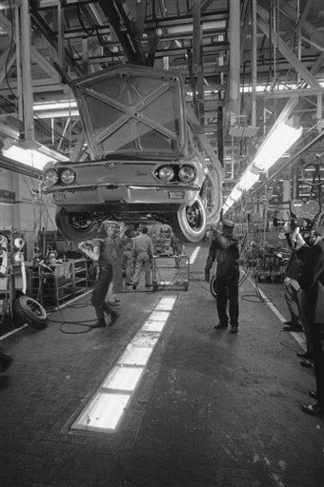 Workmen at Chevrolet\'s Willow Run plant finish assembling the last Corvair that General Motors will build in Willow Run, Mich., May 14, 1969. 1,710,00-rear engine Corvairs were built with the first rolling off the assembly line is the fall of 1959. The car was GM\'s answer to the compact movement. (AP Photo/Richard Sheinwald)