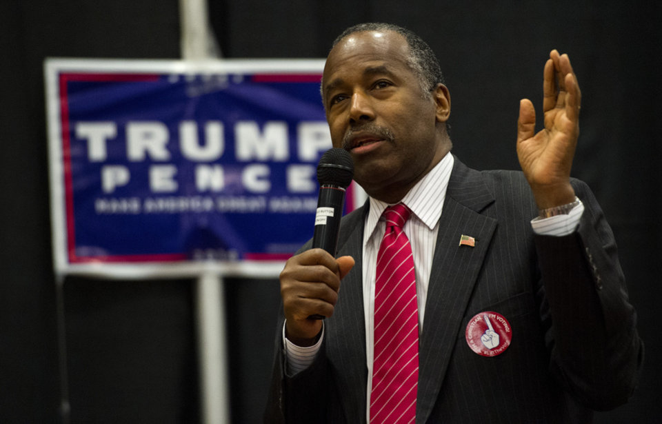 Photo - Republican Dr. Ben Carson speaks during a rally for Republican presidential candidate Donald Trump Friday, Nov. 4, 2016, at The Classical Academy in Colorado Springs, Colo. Dr. Carson and Oklahoma Gov. Mary Fallin campaigned for Trump.  (Christian Murdock/The Gazette via AP)