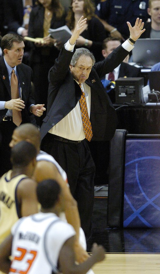 Photo - SAN ANTONIO, TEXAS, SATURDAY, APRIL 3, 2004. OKLAHOMA STATE UNIVERSITY  (OSU)  VS GEORGIA TECH COLLEGE BASKETBALL.  Oklahoma State head coach Eddie Sutton reacts to a game-tying 3-point shot by OSU's John Lucas against Georgia Tech in the second half of their NCAA Tournament Men's Final Four semifinal game at the Alamodome in San Antonio, Texas, Saturday, April 3, 2004.  OSU lost to Ga. Tech 67-65. Staff Photo by Steve Gooch.