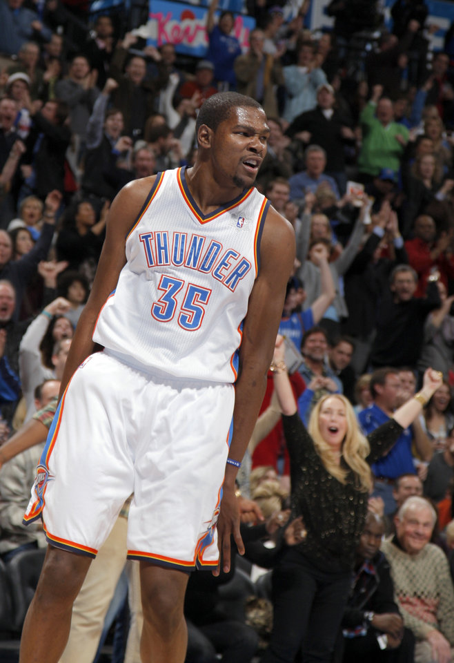 Oklahoma City Thunder's Kevin Durant (35) celebrates a basket during the opening day NBA basketball game between the Oklahoma CIty Thunder and the Orlando Magic at Chesapeake Energy Arena in Oklahoma City, Sunday, Dec. 25, 2011. Photo by Sarah Phipps, The Oklahoman