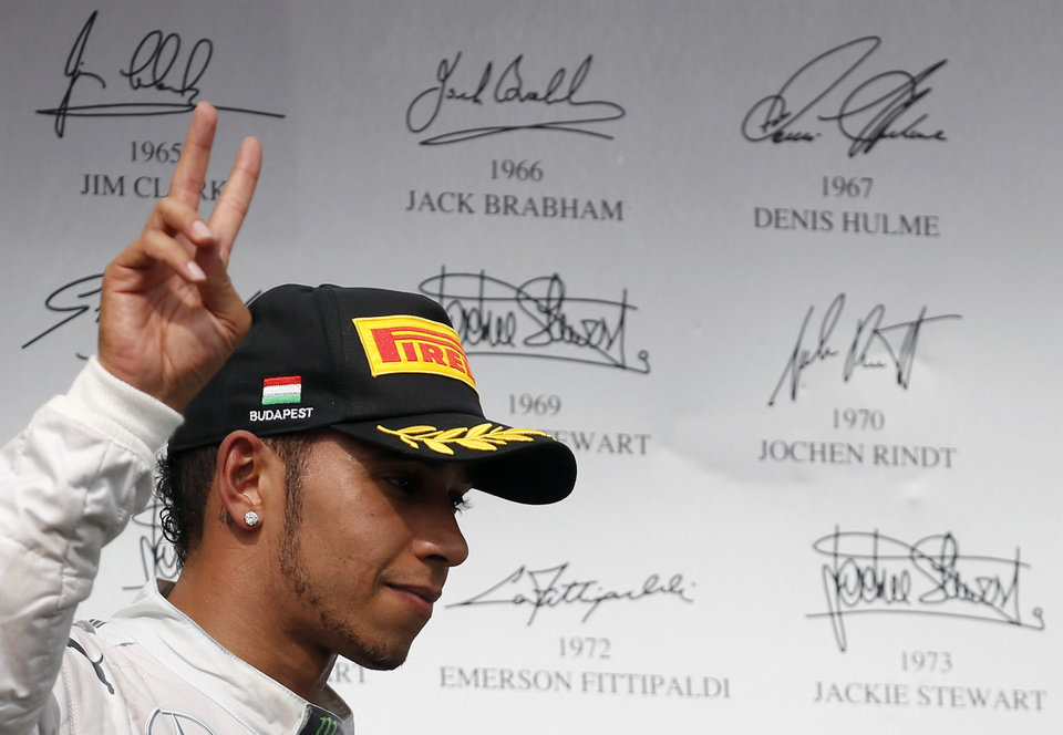 Photo - Mercedes driver Lewis Hamilton of Britain greets spectators after placing third in the Hungarian Formula One Grand Prix in Budapest, Hungary, Sunday, July 27, 2014. Hamilton placed third in the race. (AP Photo/Darko Vojinovic)