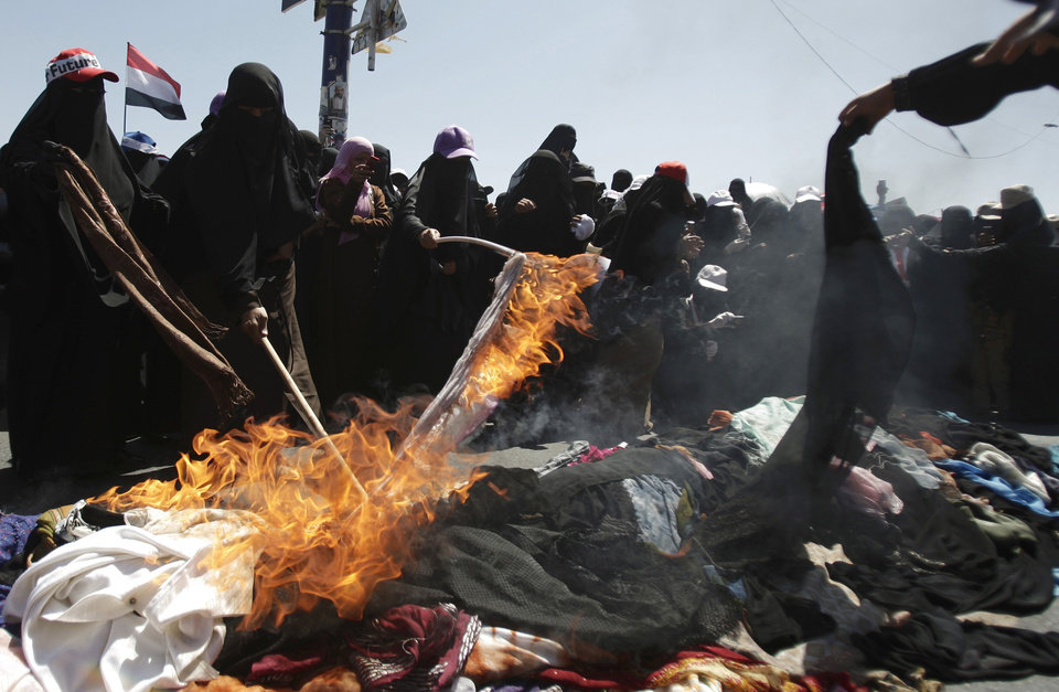 Yemeni women protestors burn their veils during a demonstration demanding the resignation of Yemeni President Ali Abdullah Saleh in Sanaa, Yemen, Wednesday, Oct. 26, 2011. (AP Photo/Hani Mohammed) ORG XMIT: AMR102