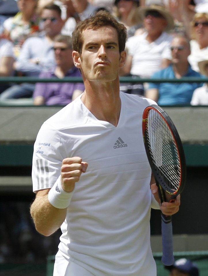 Photo - Andy Murray of Britain celebrates after winning a point against Biaz Rola of Slovenia during their men's singles match at the All England Lawn Tennis Championships in Wimbledon, London, Wednesday, June 25, 2014. (AP Photo/Sang Tan)
