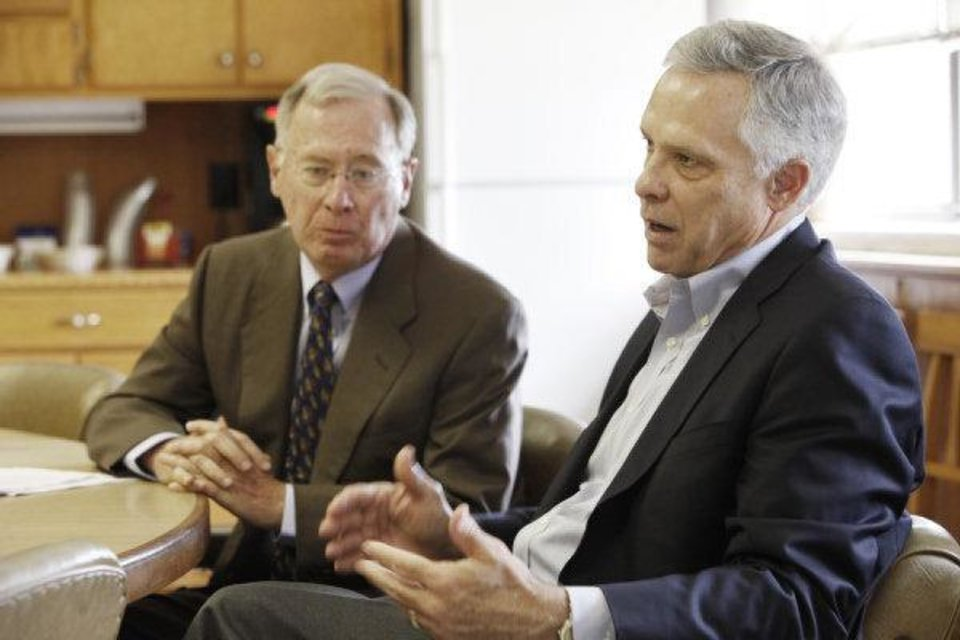 Phil Horning, left and Kirk Humphreys discuss their negotiations to create a unique charter school in downtown Oklahoma City managed by a public-private partnership. Photo by Steve Gooch <strong>Steve Gooch</strong>