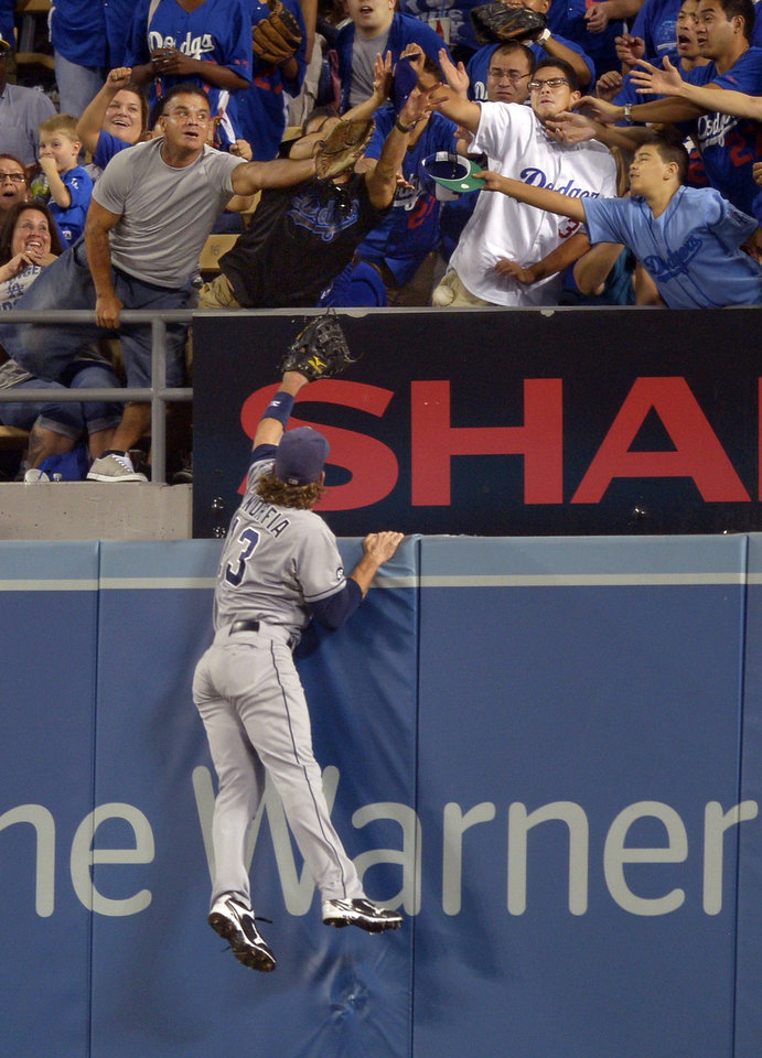 Photo -   San Diego Padres right fielder Chris Denorfia can't reach a ball hit for a solo home run by Los Angeles Dodgers' Andre Ethier during the second inning of their baseball game, Tuesday, Sept. 4, 2012, in Los Angeles. (AP Photo/Mark J. Terrill)