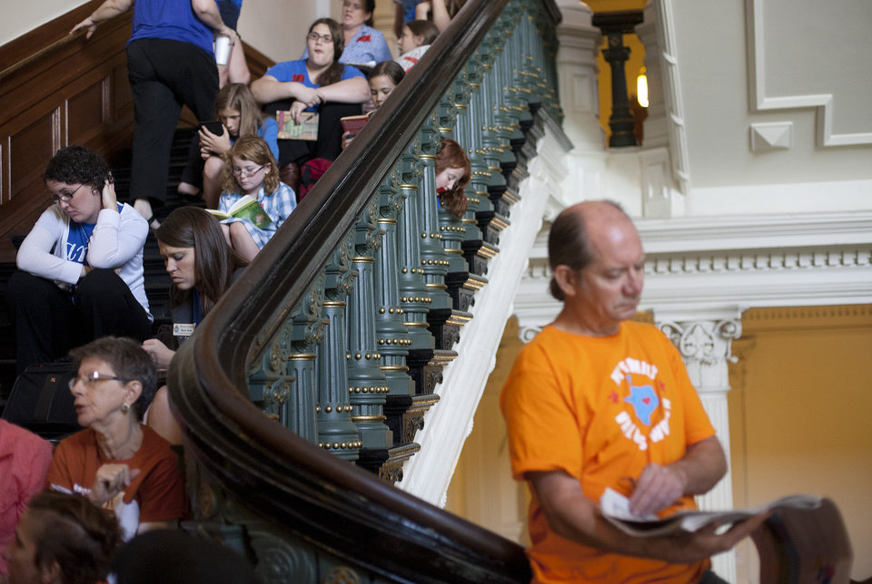 Hundreds wait in line to enter the Senate gallery at the Texas State Capitol in Austin, Texas, Friday, July 12, 2013. The Texas Senate leader, Lt. Gov. David Dewhurst, has scheduled a vote for Friday on the same restrictions on when, where and how women may obtain abortions in Texas that failed to become law after a Democratic filibuster and raucous protesters were able to run out the clock on an earlier special session. (AP Photo/Tamir Kalifa)