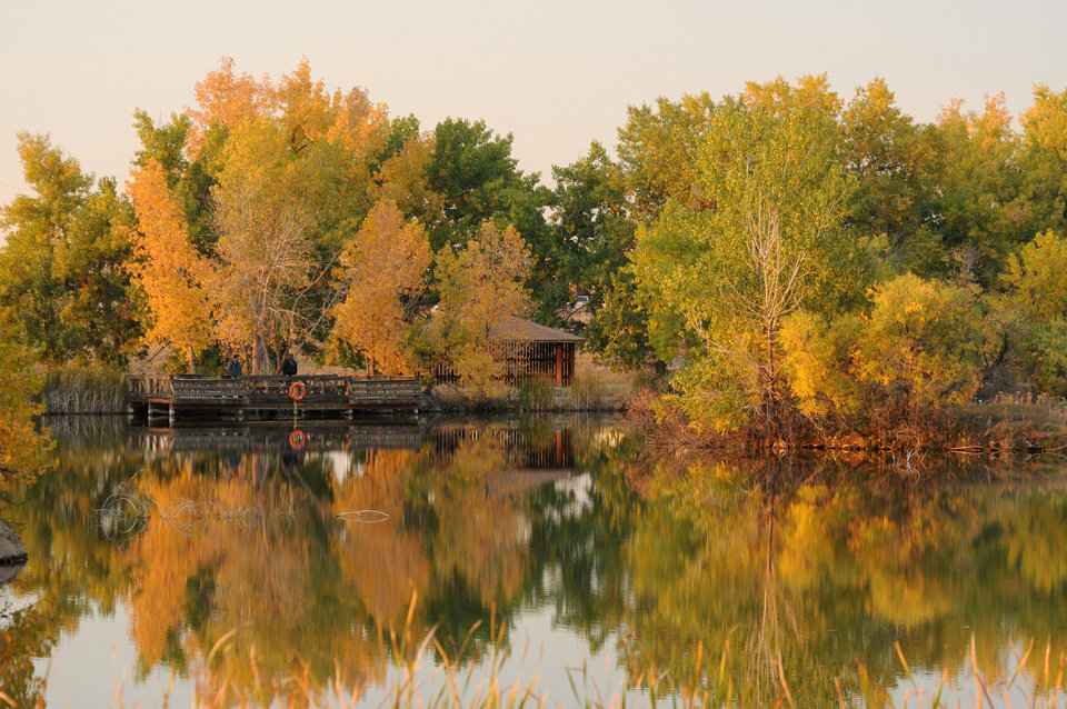This undated photo supplied by the U.S. Fish and Wildlife Service shows fall color at a lake in Rocky Mountain Arsenal Wildlife Refuge in Commerce City, Colo. The park, which opens a do-it-yourself nine-mile Wildlife Drive Oct. 13, is located just outside of Denver. (AP Photo/Rick Keen/DPRA)