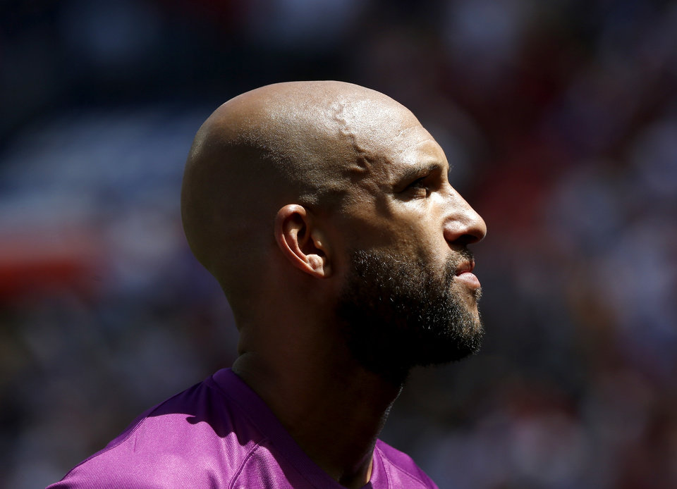 Photo - United States goalkeeper Tim Howard looks on before the start of an international soccer friendly against Turkey, Sunday, June 1, 2014, in Harrison, N.J. The U.S. won 2-1. (AP Photo/Julio Cortez)