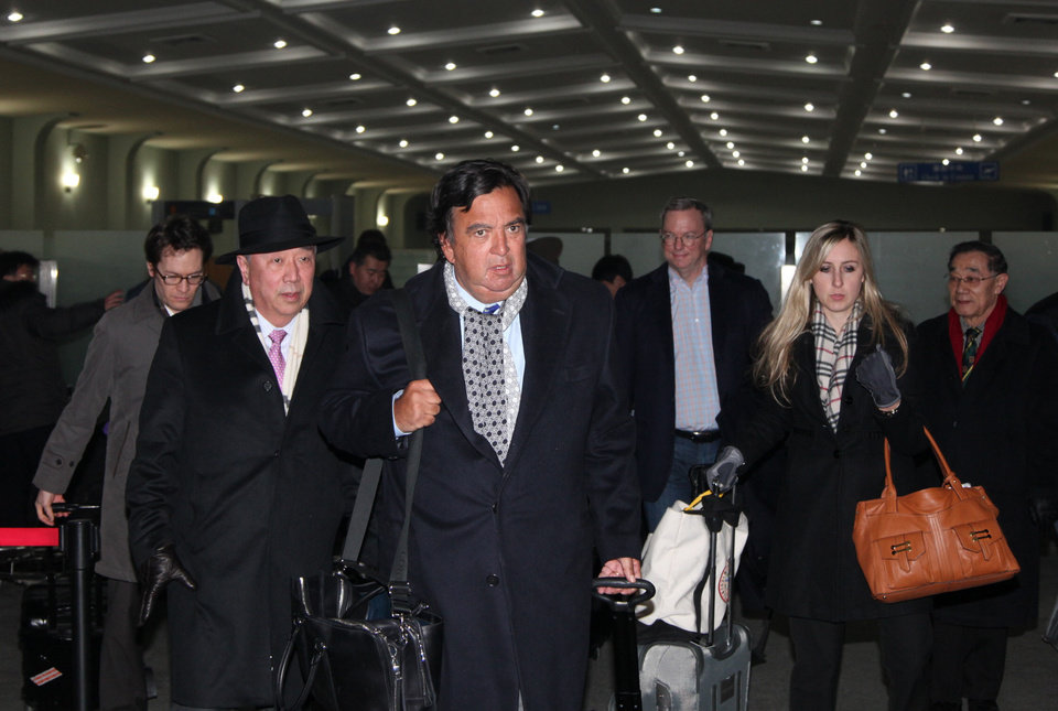 Photo - In this photo provided by China's Xinhua News Agency, former New Mexico Gov. Bill Richardson, center, and Google Executive Chairman Eric Schmidt, third right, arrive at an airport in Pyongyang, North Korea, Monday,  Jan. 7, 2013. The Google chairman wants a first-hand look at North Korea's economy and social media in his private visit Monday to the communist nation, his delegation said, despite misgivings in Washington over the timing of the trip.  (AP Photo/Xinhua, Zhang Li) NO SALES