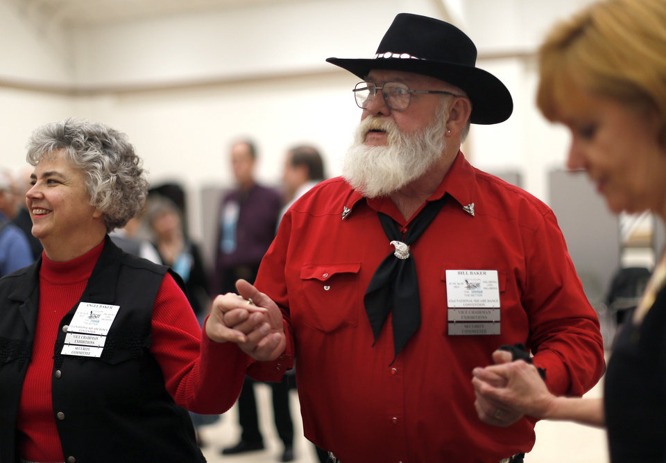 Angel and Bill Baker dance during a Teacup Chains square dance in Edmond in January. The Bakers are helping plan the 62nd National Square Dance Convention that gets underway later this month in Oklahoma City.  Photo by Sarah Phipps, The Oklahoman <strong>SARAH PHIPPS - SARAH PHIPPS</strong>