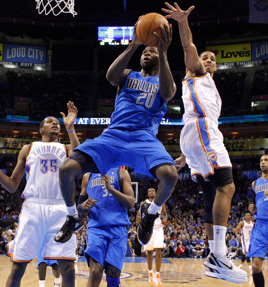 Photo - Dallas' Dominique Jones (20) goes between Oklahoma City's' Kevin Durant (35) and Thabo Sefolosha (2) during a preseason NBA game between the Oklahoma City Thunder and the Dallas Mavericks at Chesapeake Energy Arena in Oklahoma City, Tuesday, Dec. 20, 2011. Photo by Bryan Terry, The Oklahoman
