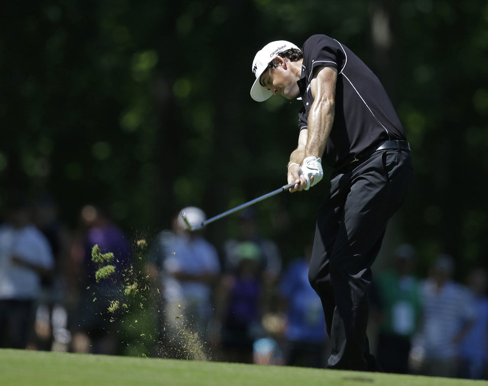 Photo - Keegan Bradley hits to the ninth green during the second round of the Memorial golf tournament Friday, May 30, 2014, in Dublin, Ohio. (AP Photo/Darron Cummings)
