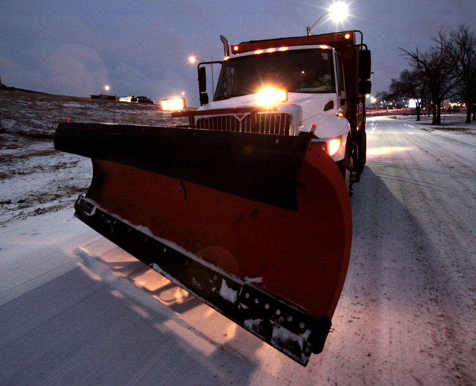 Photo - Snowplow driver Larry Fleming heads to the next streets in northwest Oklahoma City, Wednesday, December, 4, 2013. Photo by David McDaniel, The Oklahoman