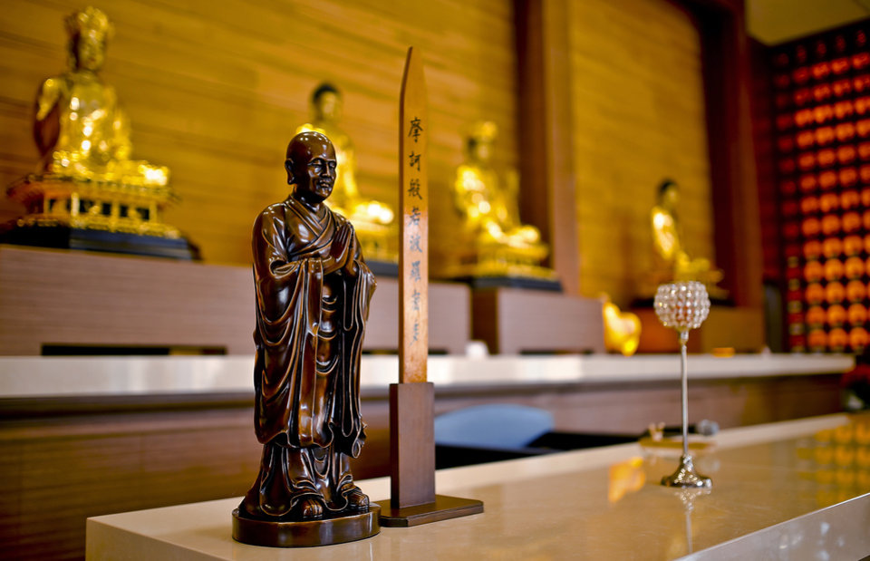 Photo -  Several statues of Buddha are featured in the meditation room in new Buddha Mind Monastery building in Oklahoma City. Photo by Chris Landsberger, The Oklahoman   CHRIS LANDSBERGER -