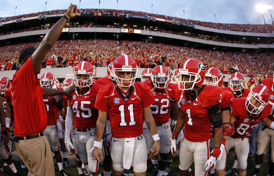 Photo -   Georgia's Christian Robinson (45), Aaron Murray (11) and Branden Smith (1) prepare to take the field with their teammates for an NCAA college football game against the Florida Atlantic Saturday, Sept. 15, 2012, in Athens, Ga. (AP Photo/John Bazemore)