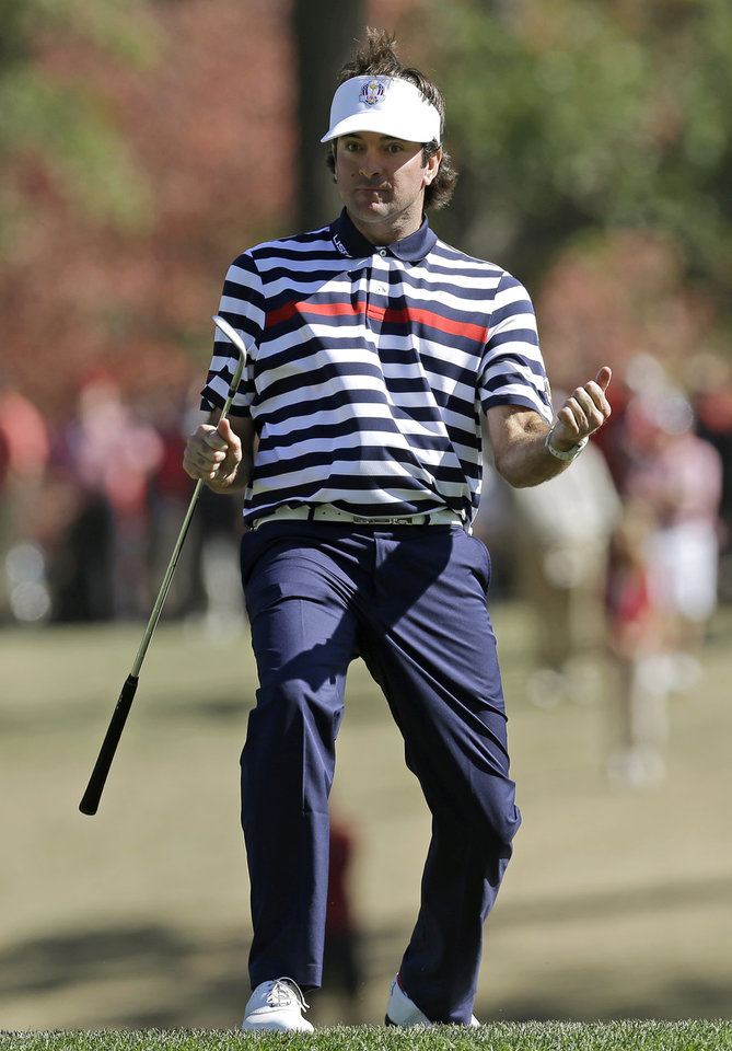 Photo - USA's Bubba Watson reacts after chipping in for a birdie on the 16th hole during a singles match at the Ryder Cup PGA golf tournament Sunday, Sept. 30, 2012, at the Medinah Country Club in Medinah, Ill. (AP Photo/David J. Phillip)  ORG XMIT: PGA150