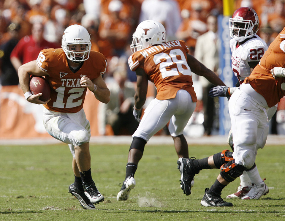 Photo - Texas' Colt McCoy (12) goes untouched as he completes a third down play late in the fourth quarter during the Red River Rivalry college football game between the University of Oklahoma Sooners (OU) and the University of Texas Longhorns (UT) at the Cotton Bowl in Dallas, Texas, Saturday, Oct. 17, 2009. Photo by Chris Landsberger, The Oklahoman