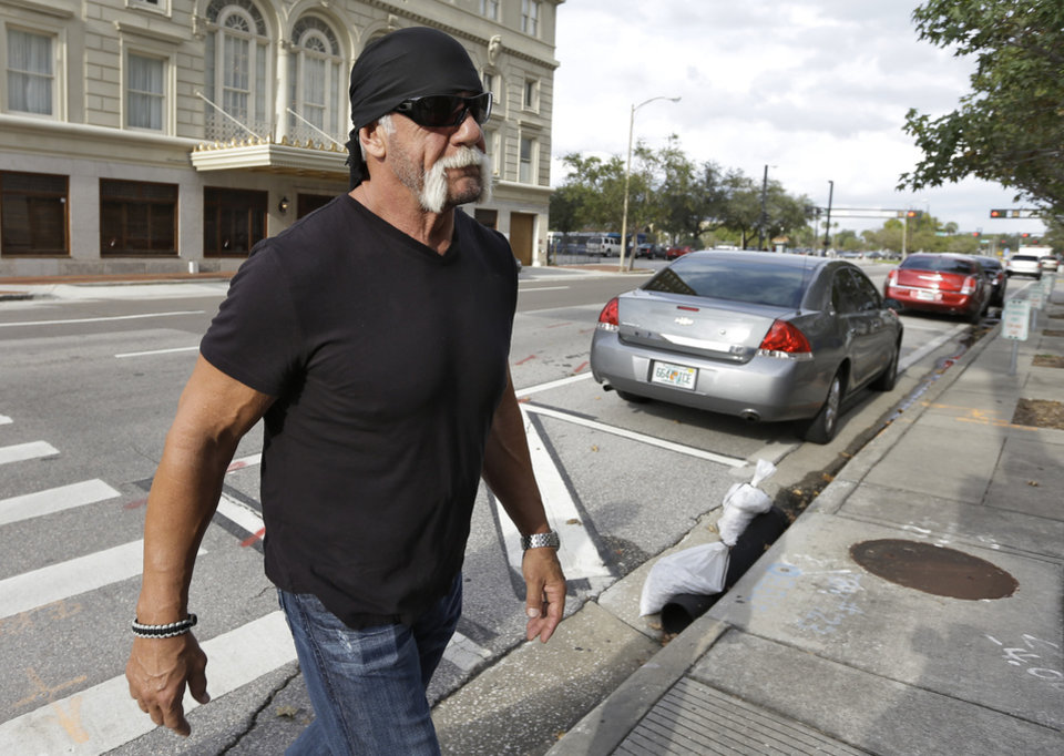 Photo -   Reality TV star and former pro wrestler Hulk Hogan, whose real name is Terry Bollea, arrives at the United States Courthouse for a news conference Monday, Oct. 15, 2012 Tampa, Fla. Hogan says he was secretly taped six years ago having sex with the ex-wife of DJ Bubba
