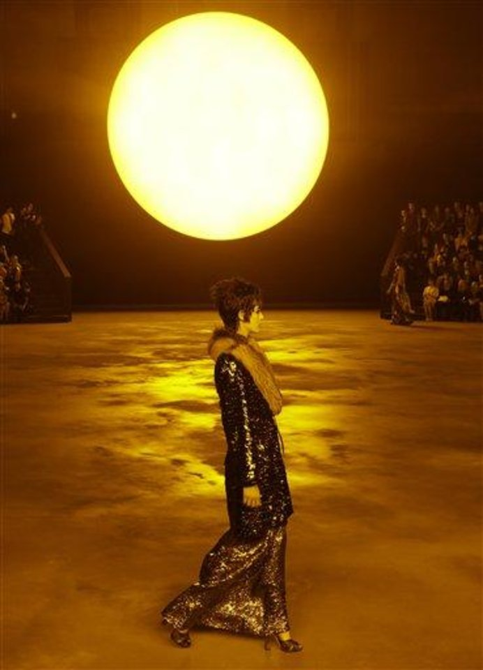 A model walks in front of a simulated setting sun during the Marc Jacobs Fall 2013 fashion show Fashion Week in New York, Thursday, Feb. 14, 2013. (AP Photo/Kathy Willens)