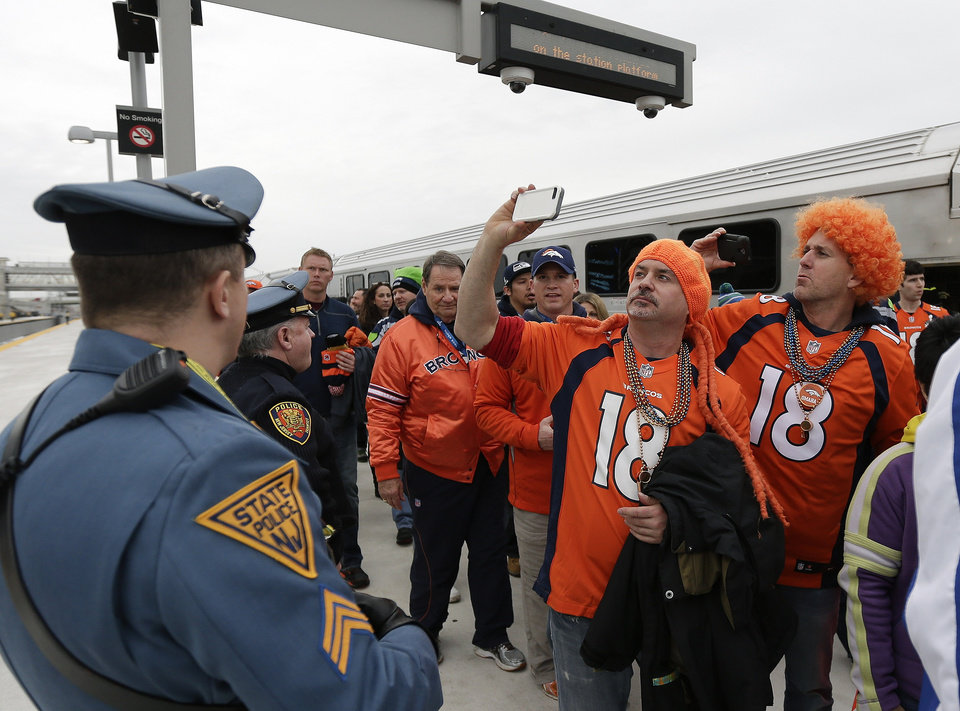 Photo - Denver Broncos fans take pictures of the stadium as they arrive at the Meadowlands Rail Station before the NFL Super Bowl XLVIII football game Sunday, Feb. 2, 2014, in East Rutherford, N.J. (AP Photo/Gregory Bull)