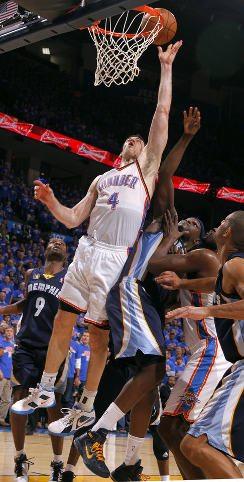 Oklahoma City\'s Nick Collison (4) shoots as Zach Randolph (50) of Memphis defends during game 7 of the NBA basketball Western Conference semifinals between the Memphis Grizzlies and the Oklahoma City Thunder at the OKC Arena in Oklahoma City, Sunday, May 15, 2011. Photo by Sarah Phipps, The Oklahoman