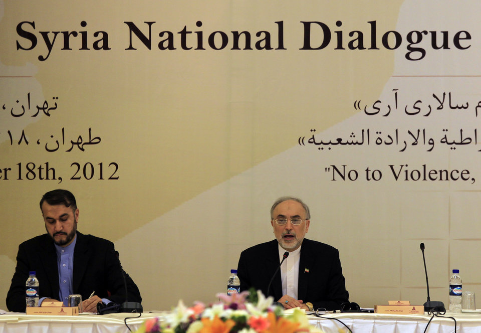 Photo -   Iranian Foreign Minister, Ali Akbar Salehi, right, speaks during the