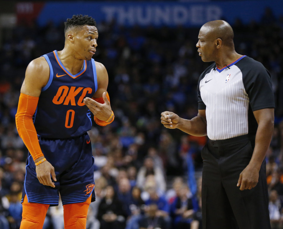 Photo - Oklahoma City's Russell Westbrook (0) talks to official Tony Brown (6) in the first quarter during an NBA basketball game between the Philadelphia 76ers and the Oklahoma City Thunder at Chesapeake Energy Arena in Oklahoma City, Thursday, Feb. 28, 2019. Photo by Nate Billings, The Oklahoman