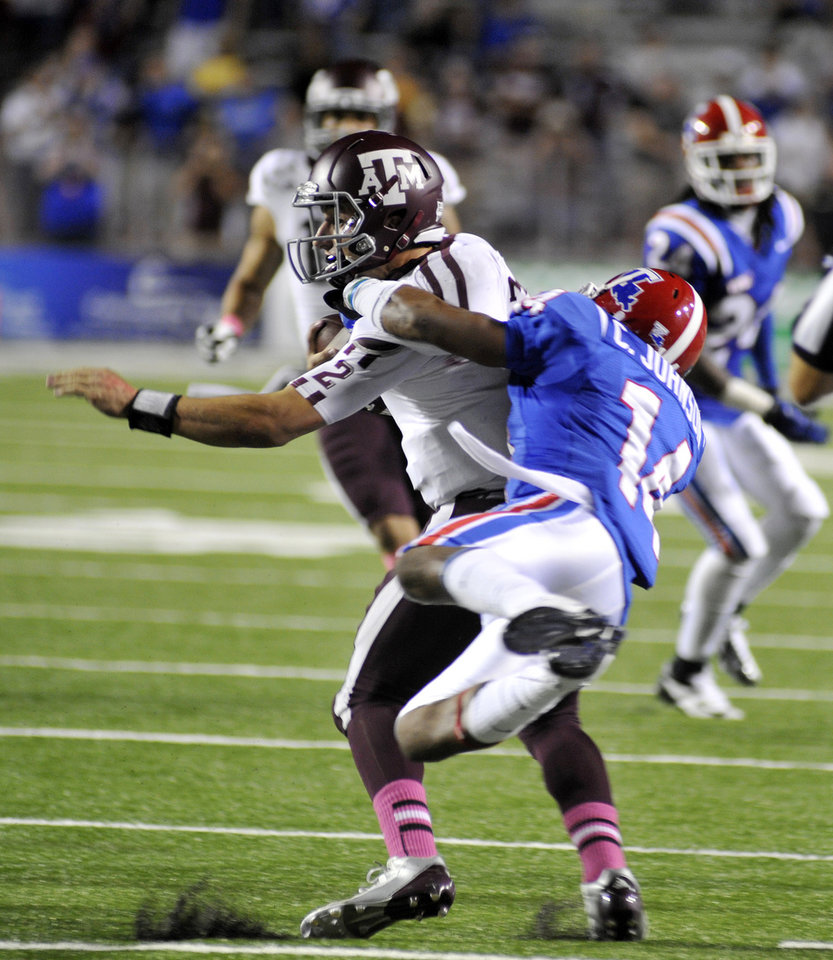 Louisiana Tech's Craig Johnson brings down Texas A& M's Johnny Manziel during an NCAA football game in Shreveport, La.,Saturday, Oct. 13, 2012. (AP Photo/Kita K Wright)
