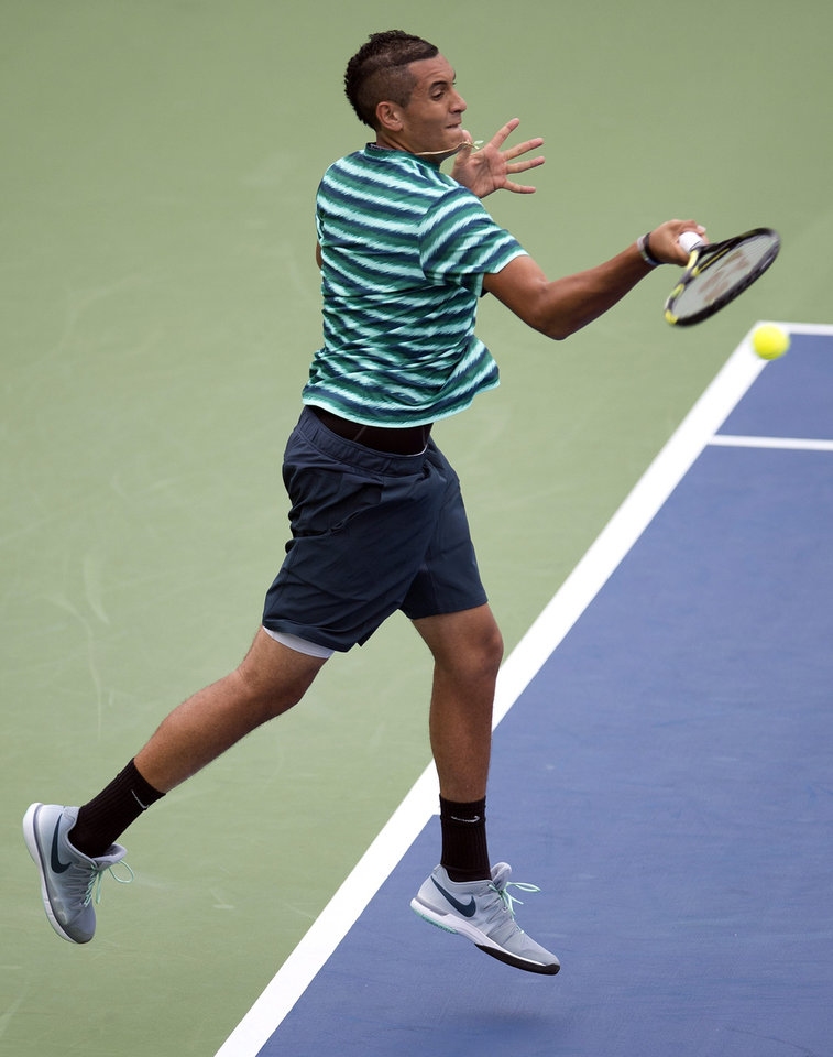 Photo - Nick Kyrgios of Australia hits a forehand to Santiago Giraldo of Colombia in Rogers Cup tennis action in Toronto on Tuesday, Aug. 5, 2014. (AP Photo/The Canadian Press, Frank Gunn)