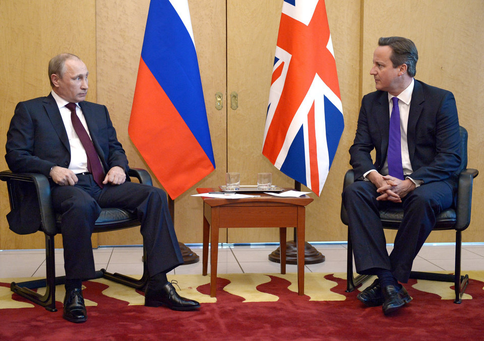 Photo - In this Thursday June 5, 2014 photo, British Prime Minister David Cameron, right, meets with Russian President Vladimir Putin at Charles De Gaulle Airport in Paris, as they are in France ahead of the 70th anniversary of D-Day commemorations. Cameron said he gave Russian president Vladimir Putin a
