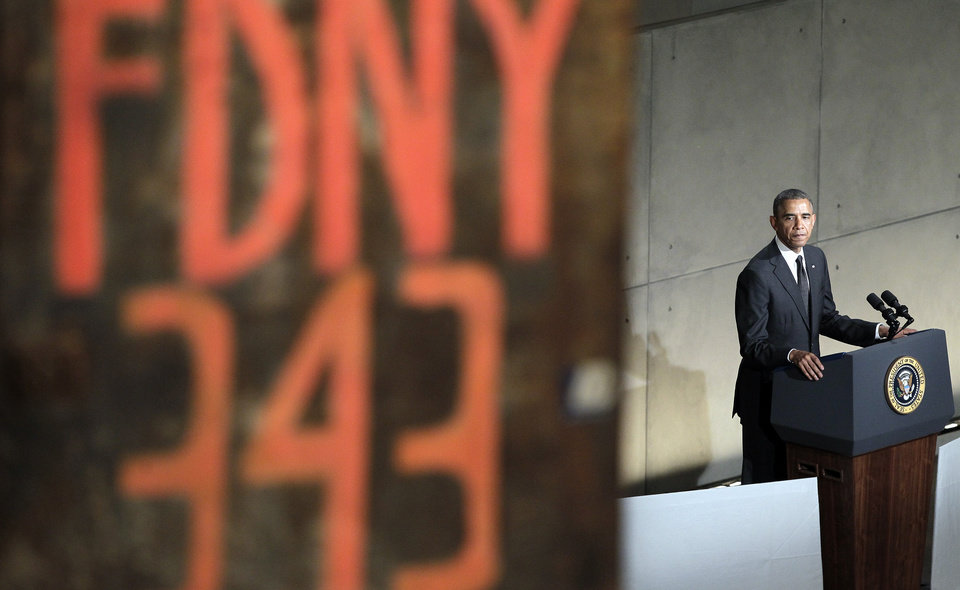 Photo - President Barack Obama speaks at the dedication ceremony for the National September 11 Memorial Museum on Thursday, May 15, 2014 in New York.  (AP Photo/John Angelillo,Pool)