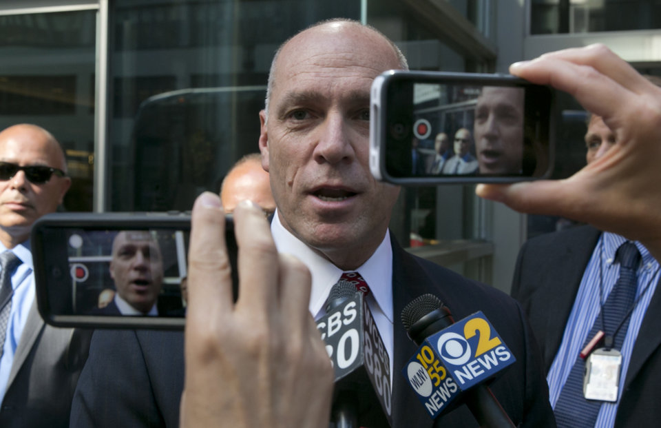 Photo - Anthony Simon, the chief negotiator for Long Island Rail Road unions, arrives for talks outside the New York office of Gov. Andrew Cuomo, Thursday, July 17, 2014. He said they were