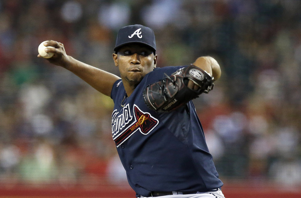 Photo - Atlanta Braves' Julio Teheran throws a pitch against the Arizona Diamondbacks during the first inning of a baseball game on Friday, June 6, 2014, in Phoenix. (AP Photo/Ross D. Franklin)