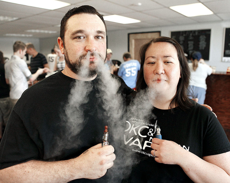 Stephanie and John Durst, owners of OKC Vapes in Oklahoma City demonstrate their product. Photo by Paul Hellstern, The Oklahoman Archives