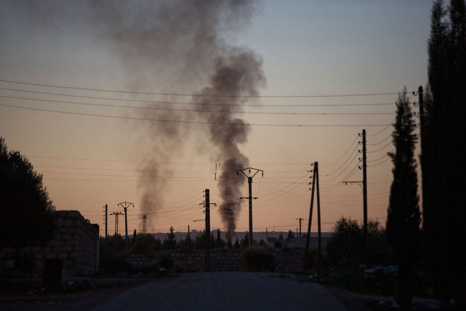 Photo - Smoke rises up after   intense fighting between Syrian Army and FSA in a military base in  Tal Sheen, Syria, Saturday, Dec 15, 2012 (AP Photo / Manu Brabo)