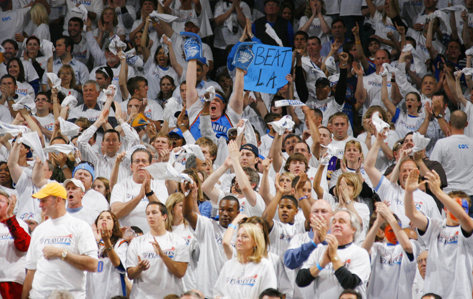 Photo -  Thunder fans celebrate during the NBA basketball game between the Los Angeles Lakers and the Oklahoma City Thunder in the first round of the playoffs at the Ford Center in Oklahoma City, Saturday, April 24, 2010. Photo by Nate Billings, The Oklahoman