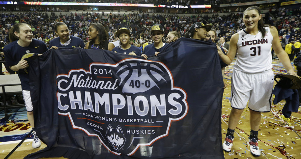 Photo - The Connecticut team celebrate their win over Notre Dame 79-58 after the second half of the championship game in the Final Four of the NCAA women's college basketball tournament, Tuesday, April 8, 2014, in Nashville, Tenn. (AP Photo/Mark Humphrey)