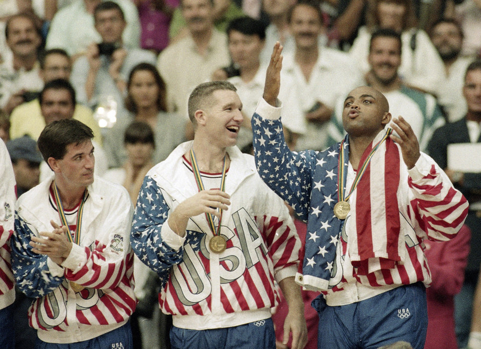 Photo -   FILE - In this Aug. 8, 1992, file photo, From left the USA's John Stockton, Chris Mullin, and Charles Barkley rejoice with their gold medals after beating Croatia 117-85 in the gold medal game in men's basketball at the Summer Olympics in Barcelona. It's not an urban legend: The Dream Team really did lose a scrimmage to a group of college stars as the future Hall of Famers prepared for the 1992 Olympics. Footage of that game is among the new behind-the-scenes material in the 20-year anniversary documentary that premieres on NBA TV on Wednesday. (AP Photo/John Gaps III, File)